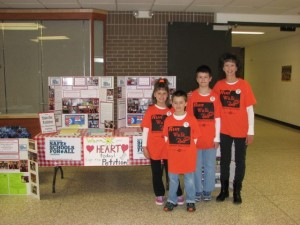 Jake, Lydia and Ben Ross and their mom, Melanie raising awareness about bullying and the need for a law to protect kids.